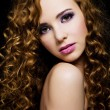Beautiful  woman with  long curly hairs - Stok fotoğraf