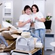Happy couple celebrating new home - Stock Photo