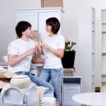 Couple celebrating new apartment — Stock Photo