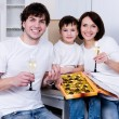 Family celebrating new home - Stock Photo