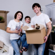 Family moving to the new flat - Stock Photo