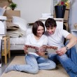 Young couple looking the photo album — Stock Photo