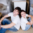 Couple sitting back-to-back after moving — Stock Photo