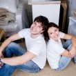 Couple sitting back-to-back after moving — Stockfoto #3468465