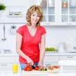 Woman preparing food in the kitchen — Stock Photo #3468657