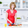 Stock Photo: Woman preparing food in the kitchen