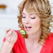 Blonde eating woman — Stock Photo