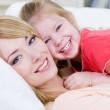 Happy mother with smiling daughter — Stock Photo