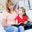 Royalty-Free Stock Photo: Mother studing her daughter to read