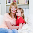 Stock Photo: Woman embracing her daughter