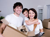 Happy family moving — Stock Photo