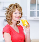 Smiling woman with a glass of juice — Stock Photo