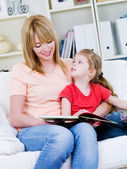Mother studing her daughter to read — Stock Photo