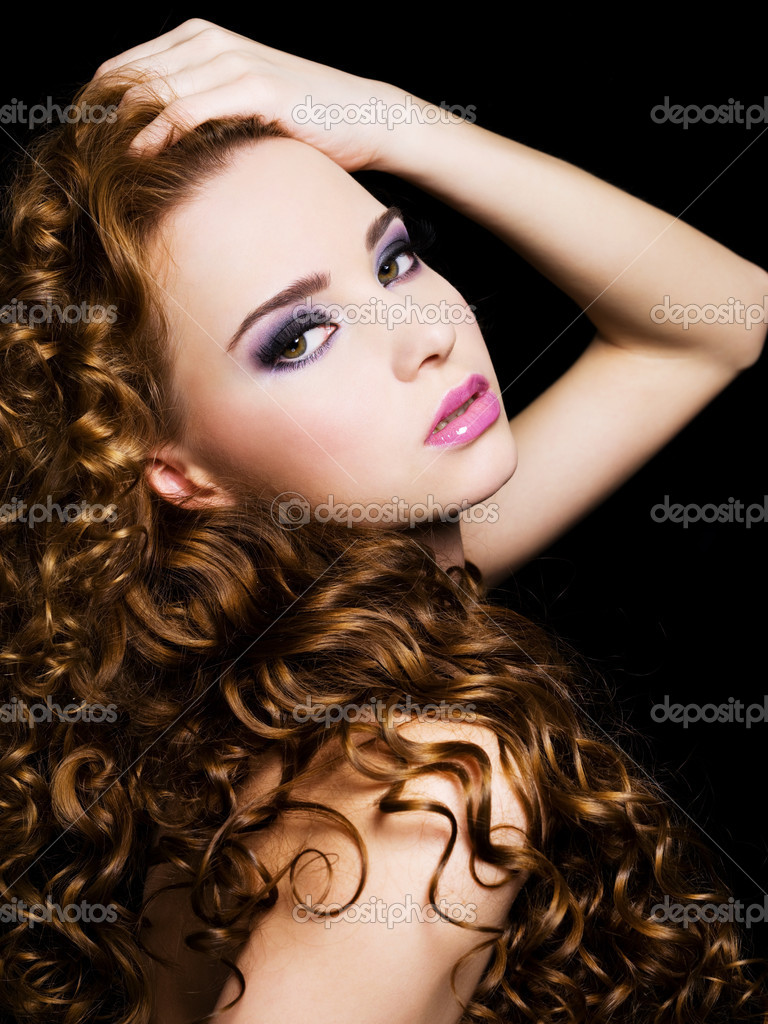 Bbeautiful  woman with beauty  long  hairs and bright pink make-up. On a black background — Stock Photo #3464223