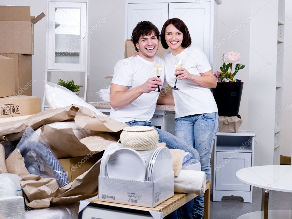 Happy couple celebrating new home stock photo for Www homedesigns com