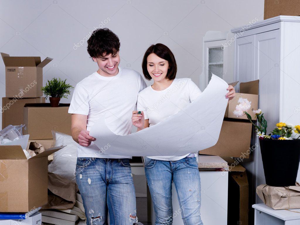Planning future flat by young cheerful couple - indoors — Stock Photo #3468273
