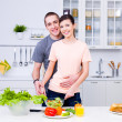 Smiling lovers cooking in the kitchen — Stock Photo