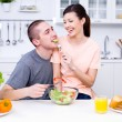 Flirting couple in the kitchen — Stock Photo