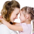 Mother with daughter in embrace — Stock Photo
