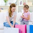 Mother with daughter after shopping — Stock Photo #3664984