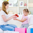 Mother giving a gift for her daughter — Stock Photo #3664991
