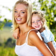 Portrait of mother and daughter outdoors — Stockfoto #3665383