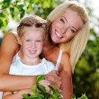Stock Photo: Portrait of mother and daughter outdoors