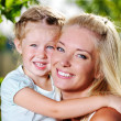 Happy faces of the  mother and  little girl — Stockfoto