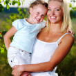 Stockfoto: Portrait of mother and daughter outdoors