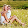 Mother and little daughter on meadow — Stock Photo
