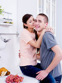 Happy lovers in the kitchen — Stock Photo