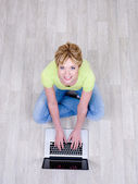 Woman with laptop on the floor — Stock Photo