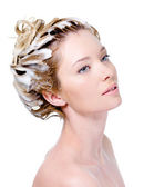 Soaping woman's head with shampoo — Stock Photo