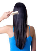 Rear view of girl combing hair — Stock Photo