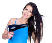 Woman drying her hair — Stock Photo