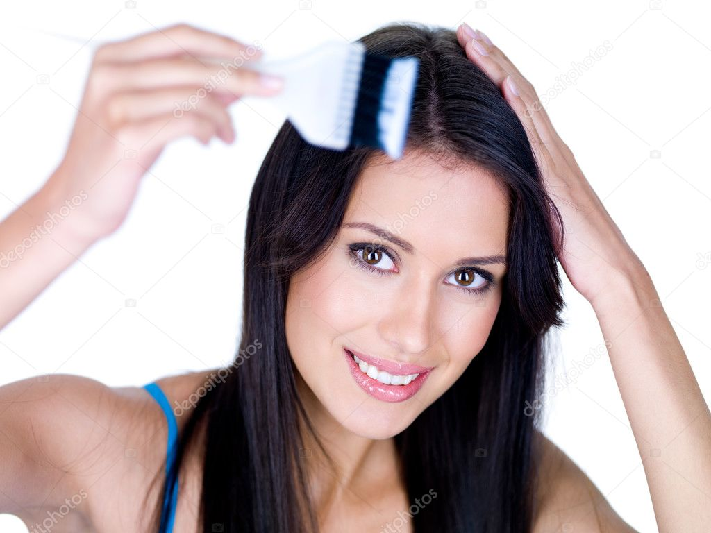 Portrait of young smiling woman coloring her long brown hair - isolated — Stock Photo #3665315