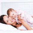 Mother with baby in bedroom — Stock Photo
