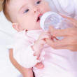 Baby with plastic bottle — Stock Photo #3703870