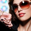 Sexy woman in fashion sunglasses — Stock Photo
