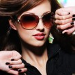 Woman with fashion sunglasses — Stock Photo