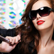 Woman with fashion sunglasses and handbag - Stock Photo