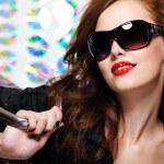 Woman with fashion sunglasses and handbag — Stock Photo