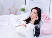 Beautiful woman lying on a bed — Stock Photo