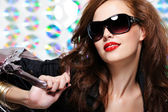Woman with fashion sunglasses and handbag — Stock Photo