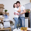 Beautiful young couple in new flat — Stock Photo
