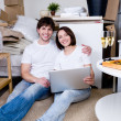 Happy couple with laptop — Stock Photo