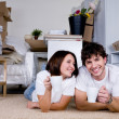 Couple drinking tea in new home — Stock Photo