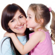 Daughter kissing her beautiful happy mother — Stock Photo