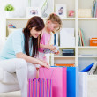 Mother and daughter with purchases - Stockfoto