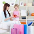 Woman and daughter with gift after shopping - Stockfoto